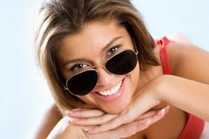 sunglasses with a smile at Riverside Eye Care